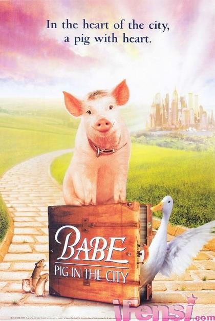 制片人米勒决定舍弃动画形式,用真的动物来演.   驯猪师卡尔.路易斯.
